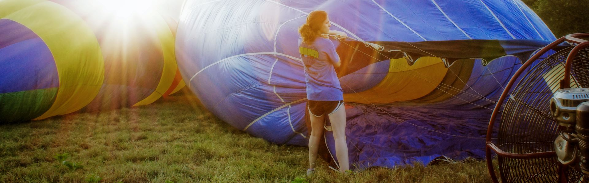 Girl assisting in inflating a hot air balloon