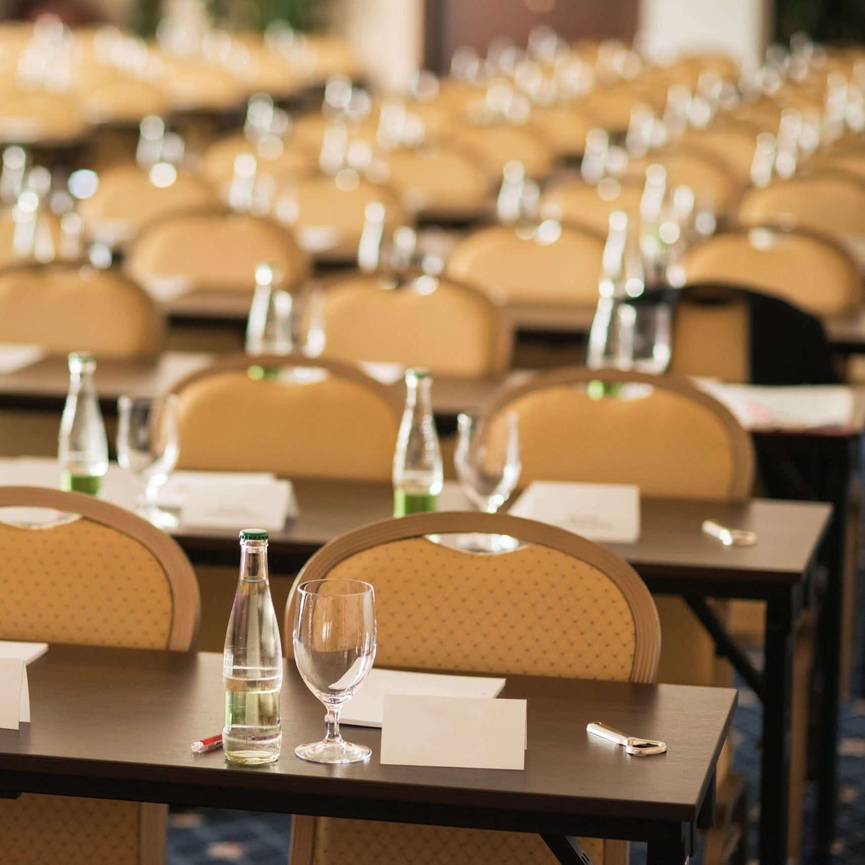Rows of tables and chairs at a Business Conference