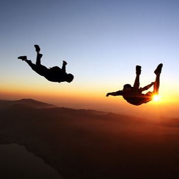 Two people sky diving