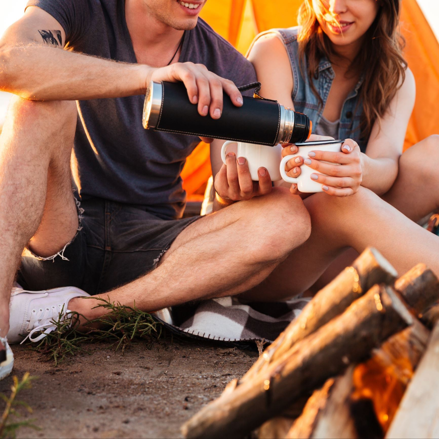 Couple camping with coffee
