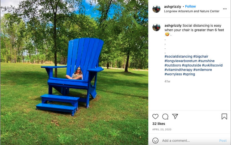 Someone sits in big blue Adirondack chair at Longview Arboretum and Nature Center